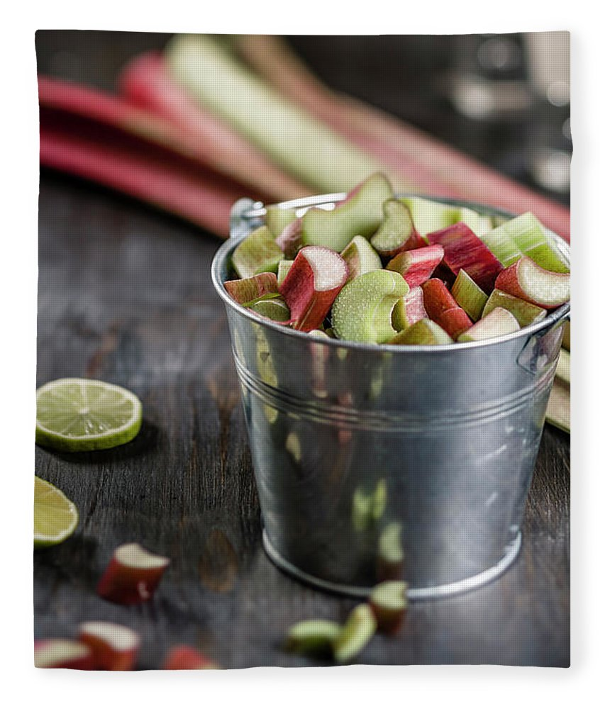 Bucket Fleece Blanket featuring the photograph Pieces Of Rhubarb In Metal Bucket And by Westend61