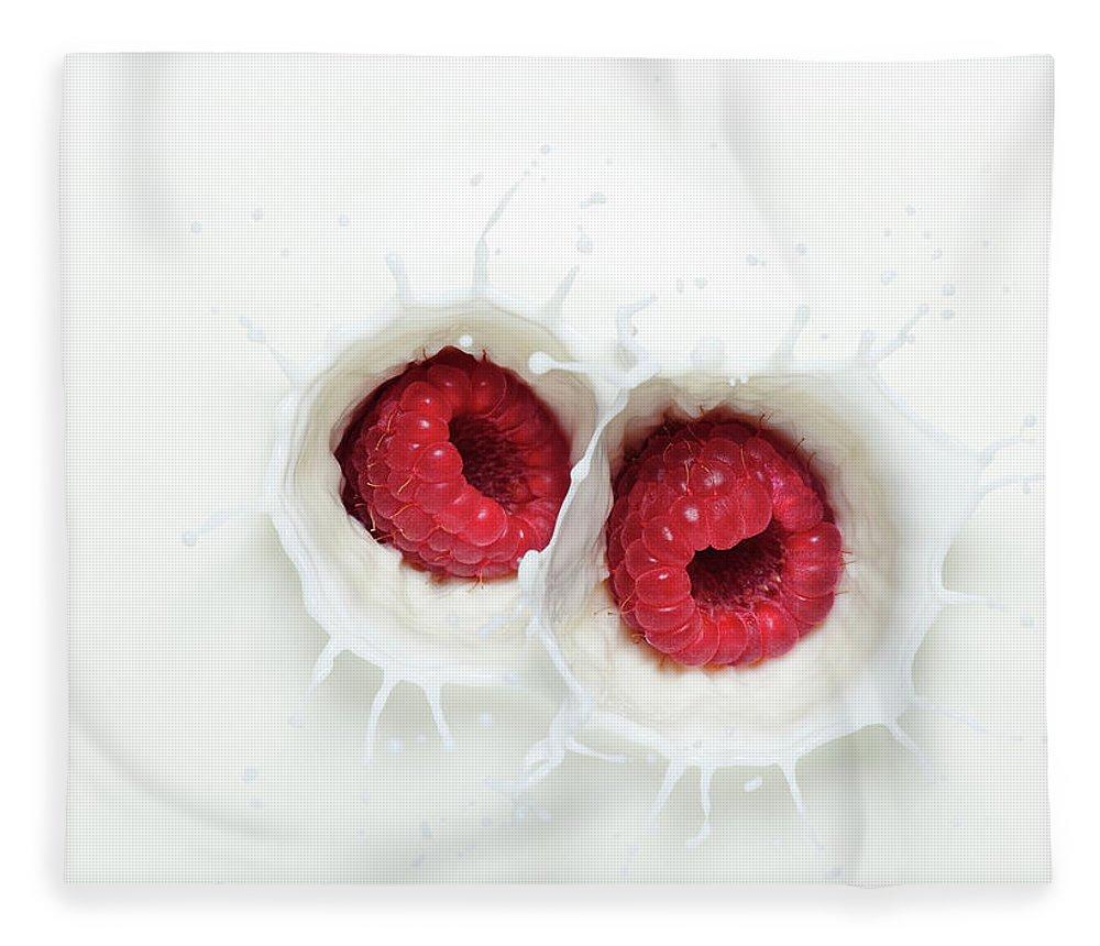 Milk Fleece Blanket featuring the photograph Raspberry Milk Splash by Chris Stein
