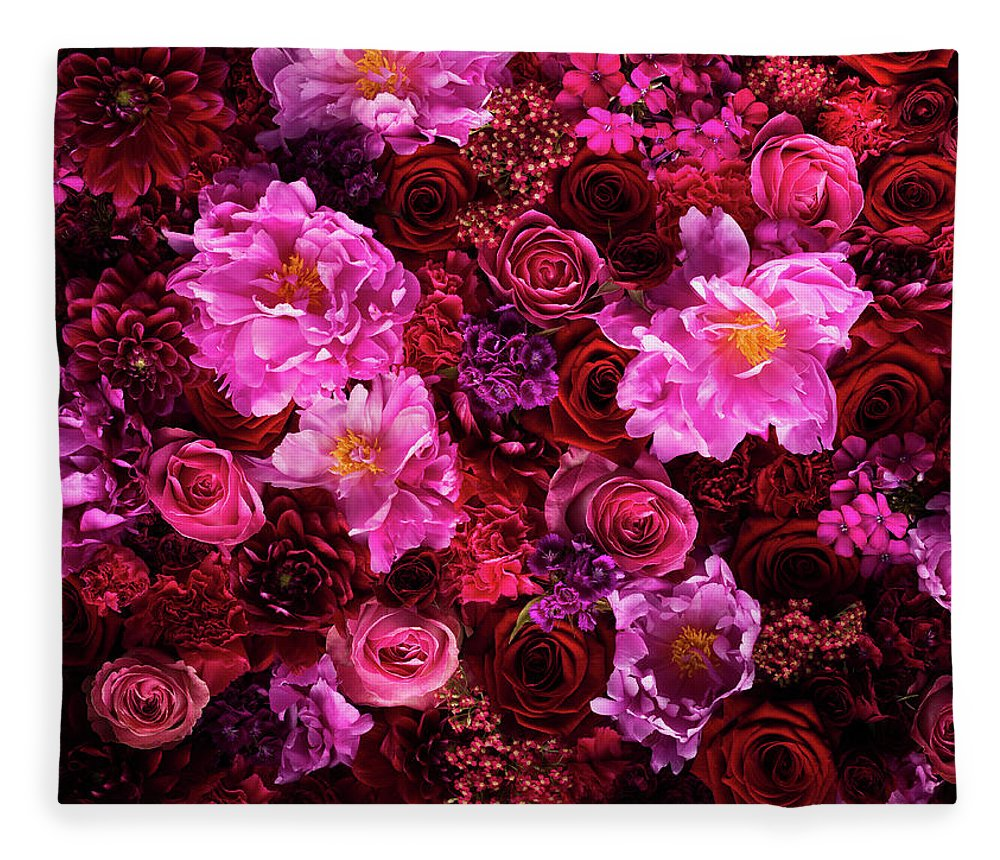 Tranquility Fleece Blanket featuring the photograph Red And Pink Cut Flowers, Close Up by Jonathan Knowles
