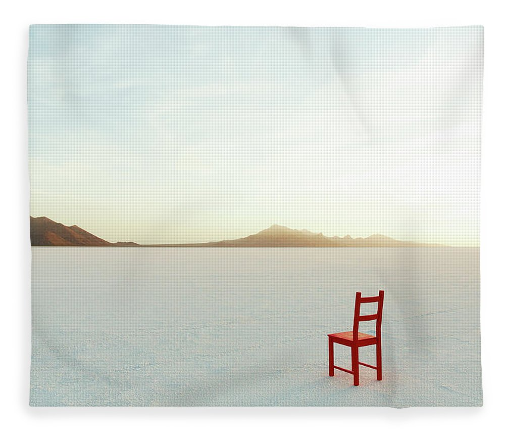 Tranquility Fleece Blanket featuring the photograph Red Chair On Salt Flats, Facing The by Andy Ryan