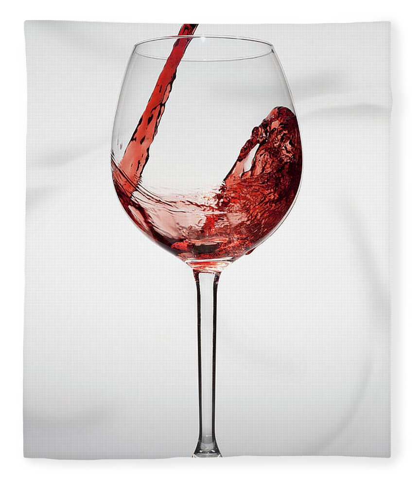 Alcohol Fleece Blanket featuring the photograph Red Wine Being Poured Into A Glass by Dual Dual