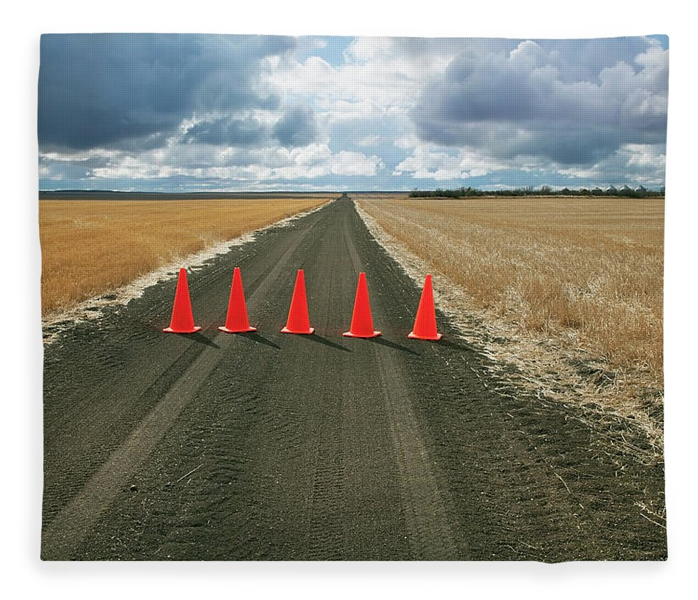 Orange Color Fleece Blanket featuring the photograph Safety Cones Lined Up Across A Rural by Benjamin Rondel / Design Pics
