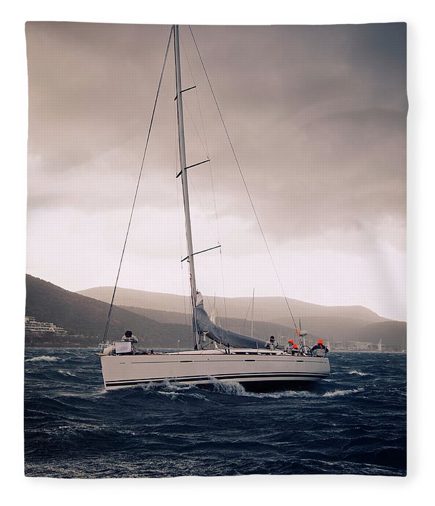 Recreational Pursuit Fleece Blanket featuring the photograph Sailing And Stormy Weather by Travenian