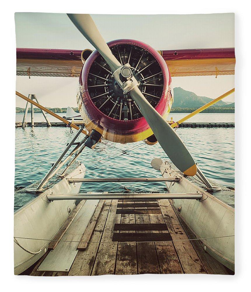 Propeller Fleece Blanket featuring the photograph Seaplane Dock by Shaunl