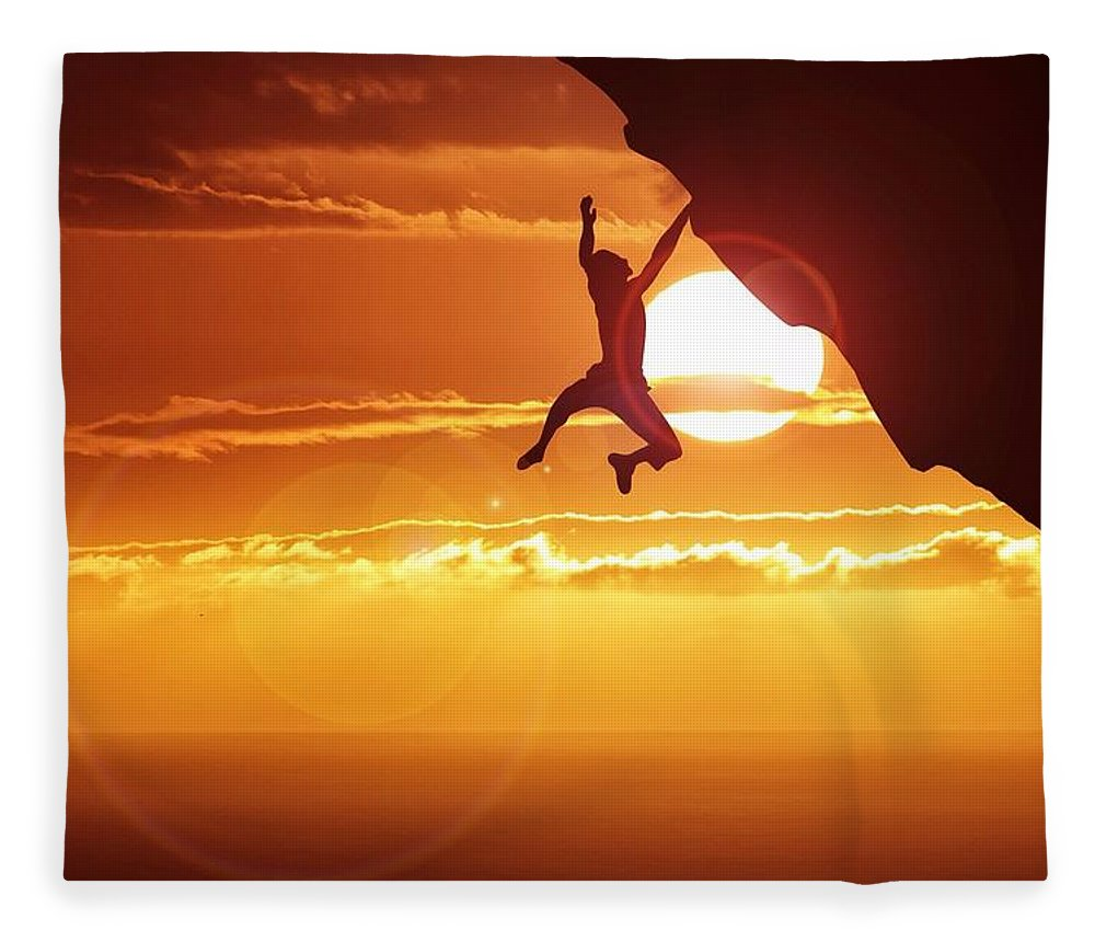 Tranquility Fleece Blanket featuring the photograph Silhouette Man Hanging On Cliff Against by Stijn Dijkstra / Eyeem