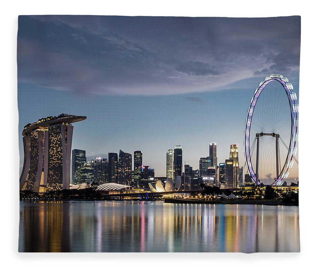 Built Structure Fleece Blanket featuring the photograph Singapore Skyline At Dusk by Martin Puddy