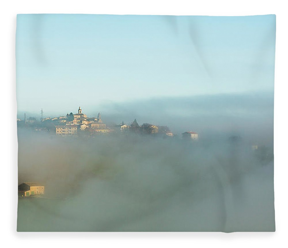 Scenics Fleece Blanket featuring the photograph Small Italian Village In The Fog by Deimagine