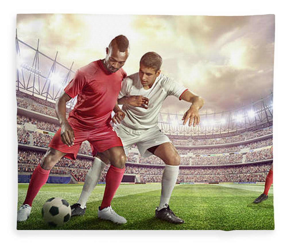 Soccer Uniform Fleece Blanket featuring the photograph Soccer Player Tackling Ball In Stadium by Dmytro Aksonov