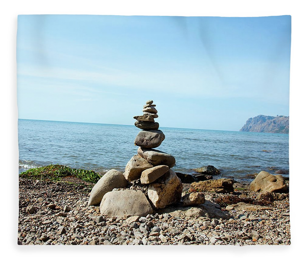 Heap Fleece Blanket featuring the photograph Stone Tower On The Beach by Mashabuba