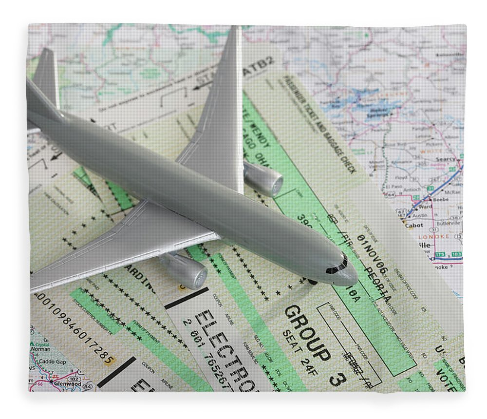 Airplane Fleece Blanket featuring the photograph Studio Shot Of Toy Airplane With by Vstock Llc