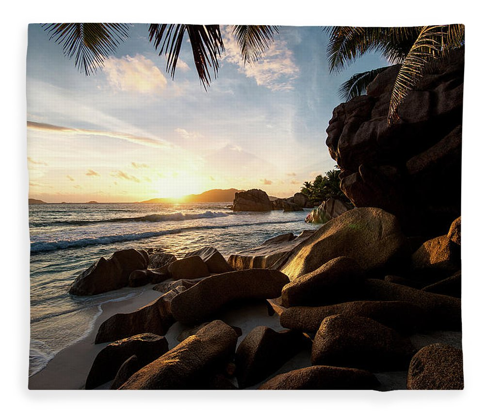 Water's Edge Fleece Blanket featuring the photograph Sunrise Framed By Palm Trees And Rock by Pitgreenwood
