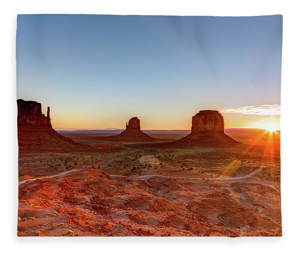 Tranquility Fleece Blanket featuring the photograph Sunrise On Monument Valley by Loic Lagarde