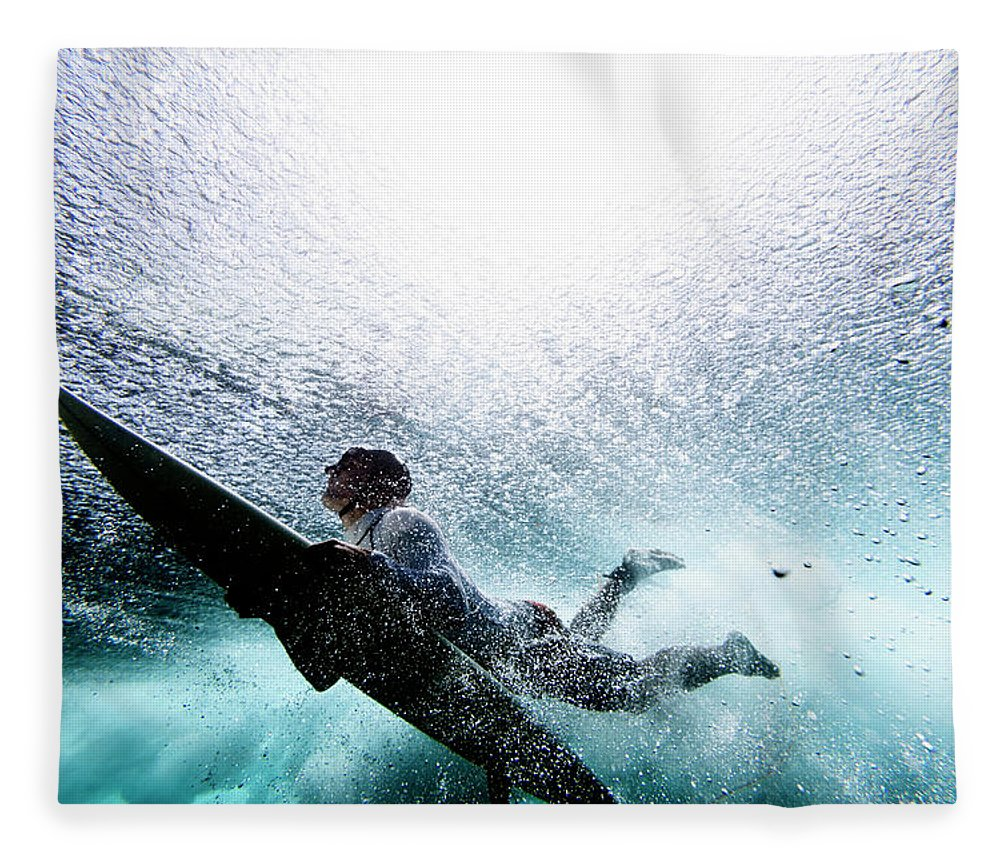 Expertise Fleece Blanket featuring the photograph Surfer Duck Diving by Subman