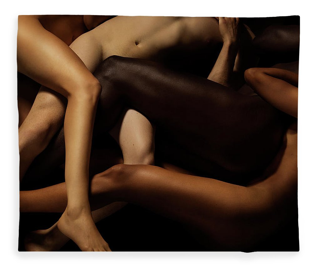 Young Men Fleece Blanket featuring the photograph Tangled Human Bodies Of Different Skin by Jonathan Knowles
