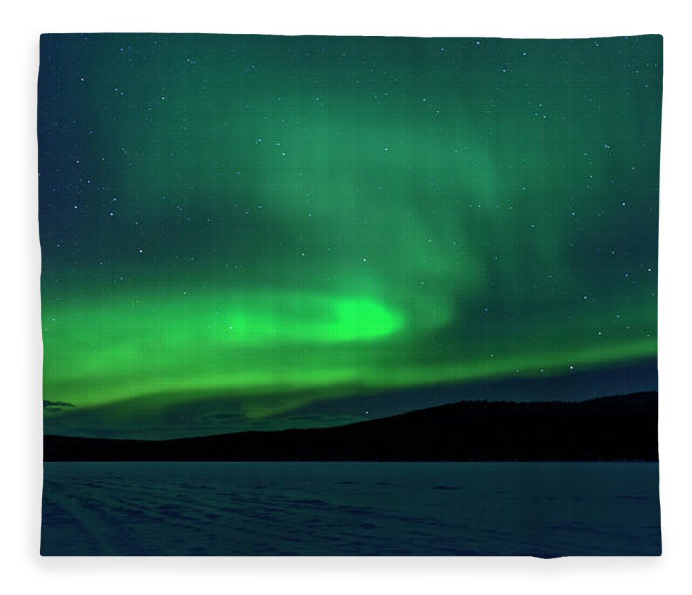 Snow Fleece Blanket featuring the photograph The Green Light Of The Aurora by Dave Moorhouse