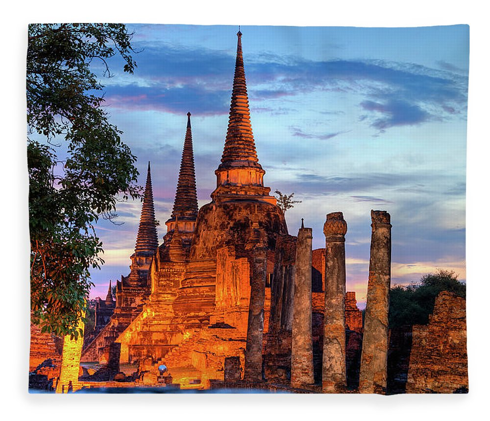 Asian And Indian Ethnicities Fleece Blanket featuring the photograph Three Illuminated Pagodas At Wat Phra by Fototrav