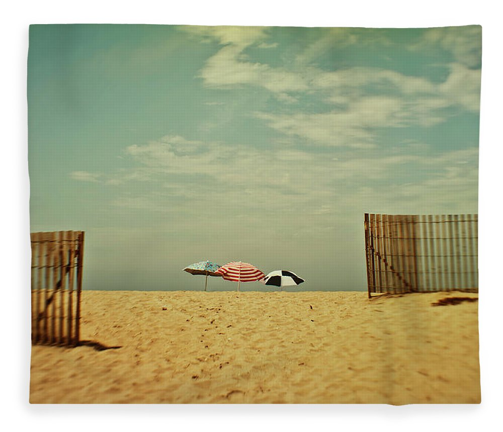 Tranquility Fleece Blanket featuring the photograph Three Umbrellas On The Beach by Suzanne Cummings