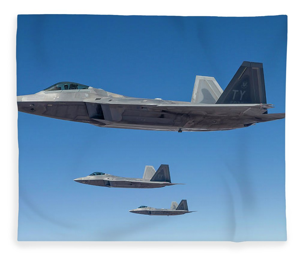Formation Flying Fleece Blanket featuring the photograph Three U.s. Air Force F-22 Raptors by Rob Edgcumbe/stocktrek Images