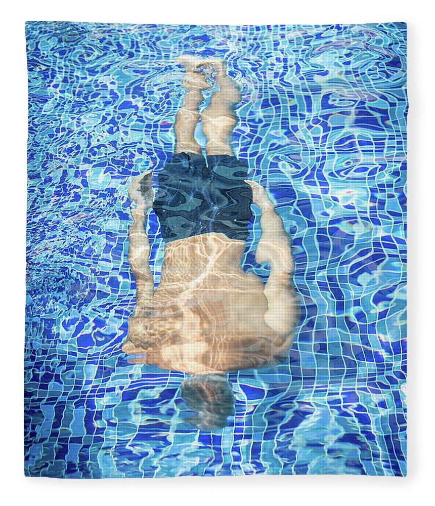Underwater Fleece Blanket featuring the photograph Top View Of Man Diving by Jasmin Merdan