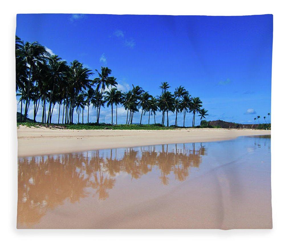 Water's Edge Fleece Blanket featuring the photograph Tranquil Nacpan Beach by Photo By Elvera Venus Tandog