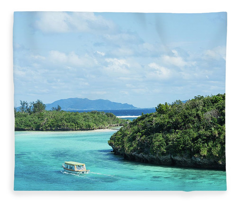 Outdoors Fleece Blanket featuring the photograph Tropical Blue Lagoon And Lush Rock by Ippei Naoi
