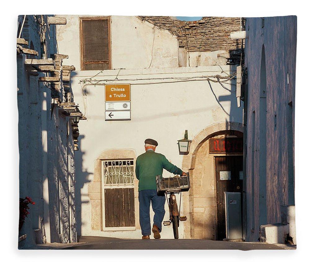 People Fleece Blanket featuring the photograph Trulli Houses Alberobello Apulia Puglia by Peter Adams