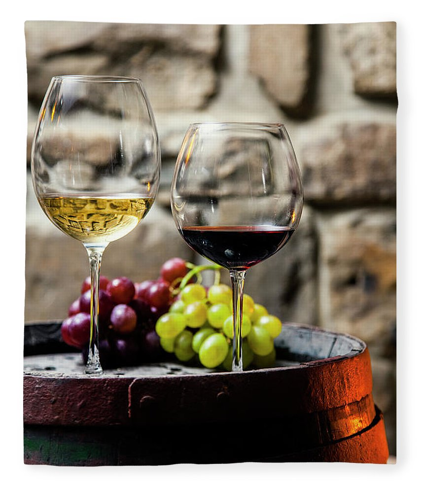 Alcohol Fleece Blanket featuring the photograph Two Glasses Of Red And White Wine In by Piranka