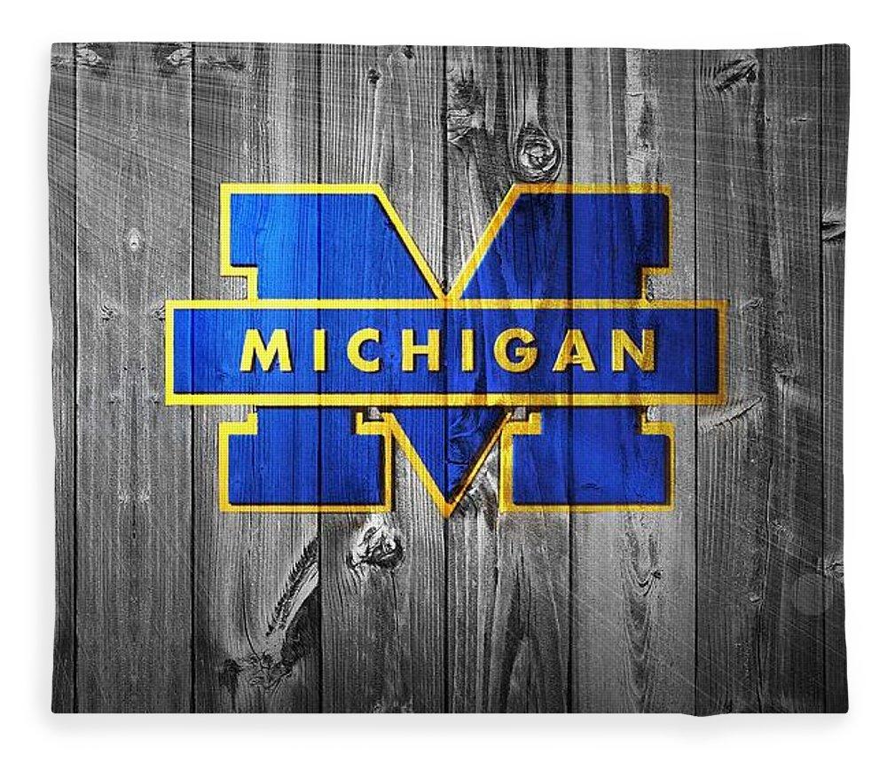 University Of Michigan Fleece Blanket featuring the digital art University Of Michigan by Dan Sproul