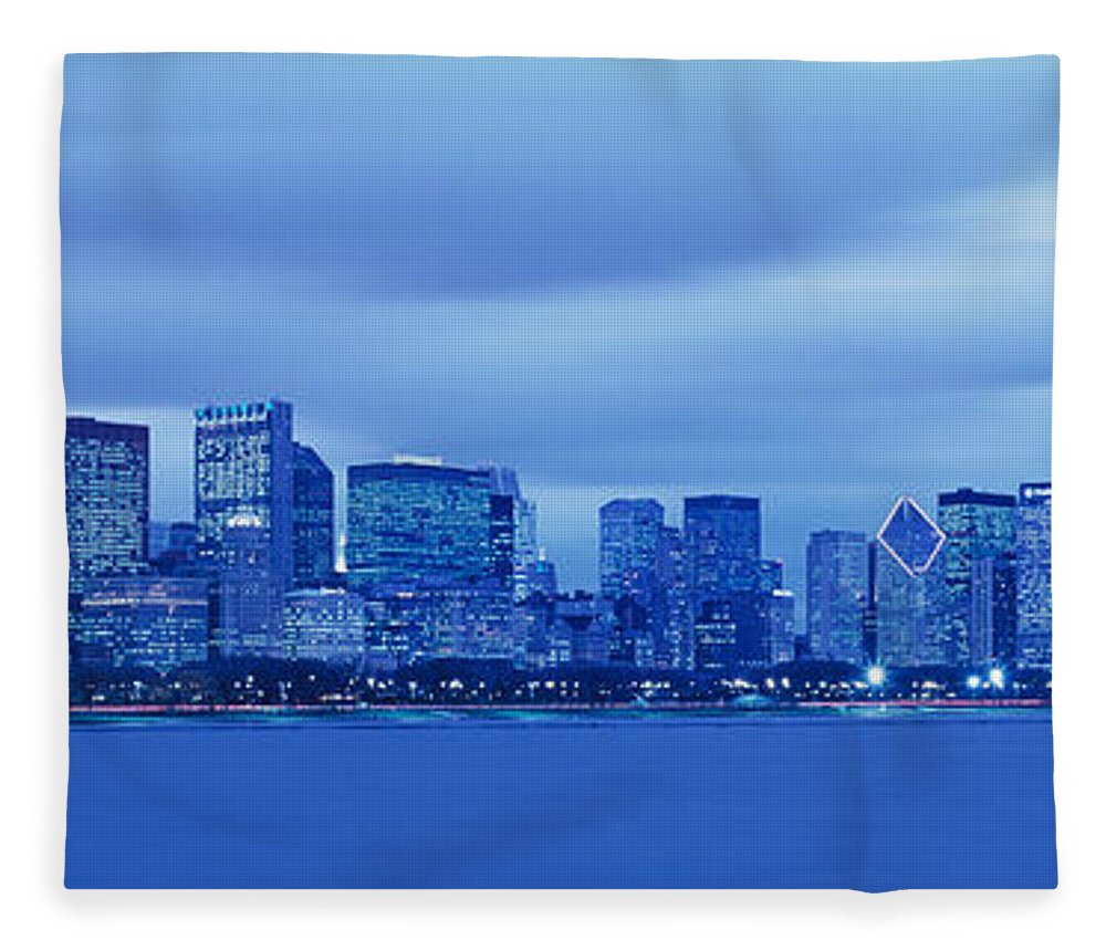 Photography Fleece Blanket featuring the photograph View Of An Urban Skyline At Dusk by Panoramic Images