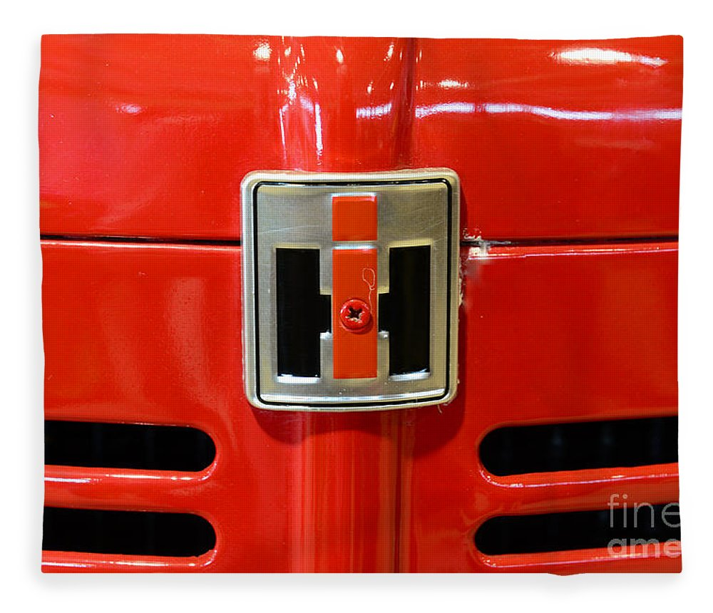 Paul Ward Fleece Blanket featuring the photograph Vintage International Harvester Tractor Badge by Paul Ward