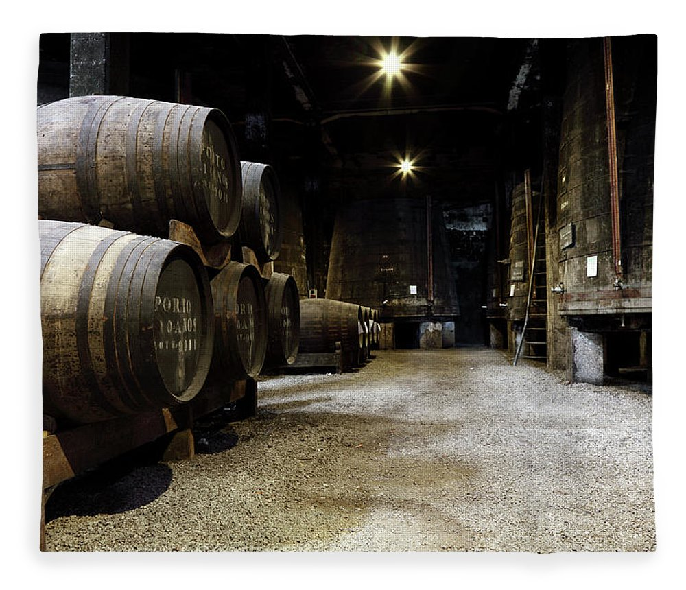 Desaturated Fleece Blanket featuring the photograph Vintage Porto Wine Cellar by Vuk8691