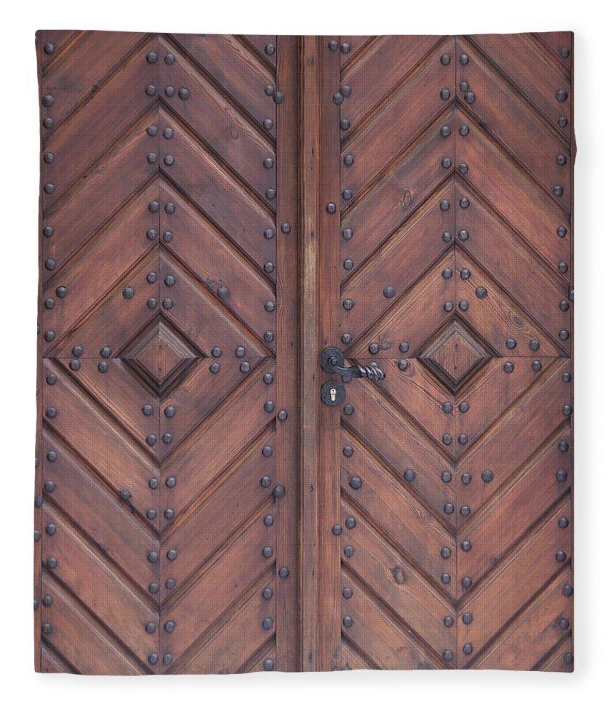 Material Fleece Blanket featuring the photograph Vintage Wooden Brown Door Close-up by Bogdan Khmelnytskyi