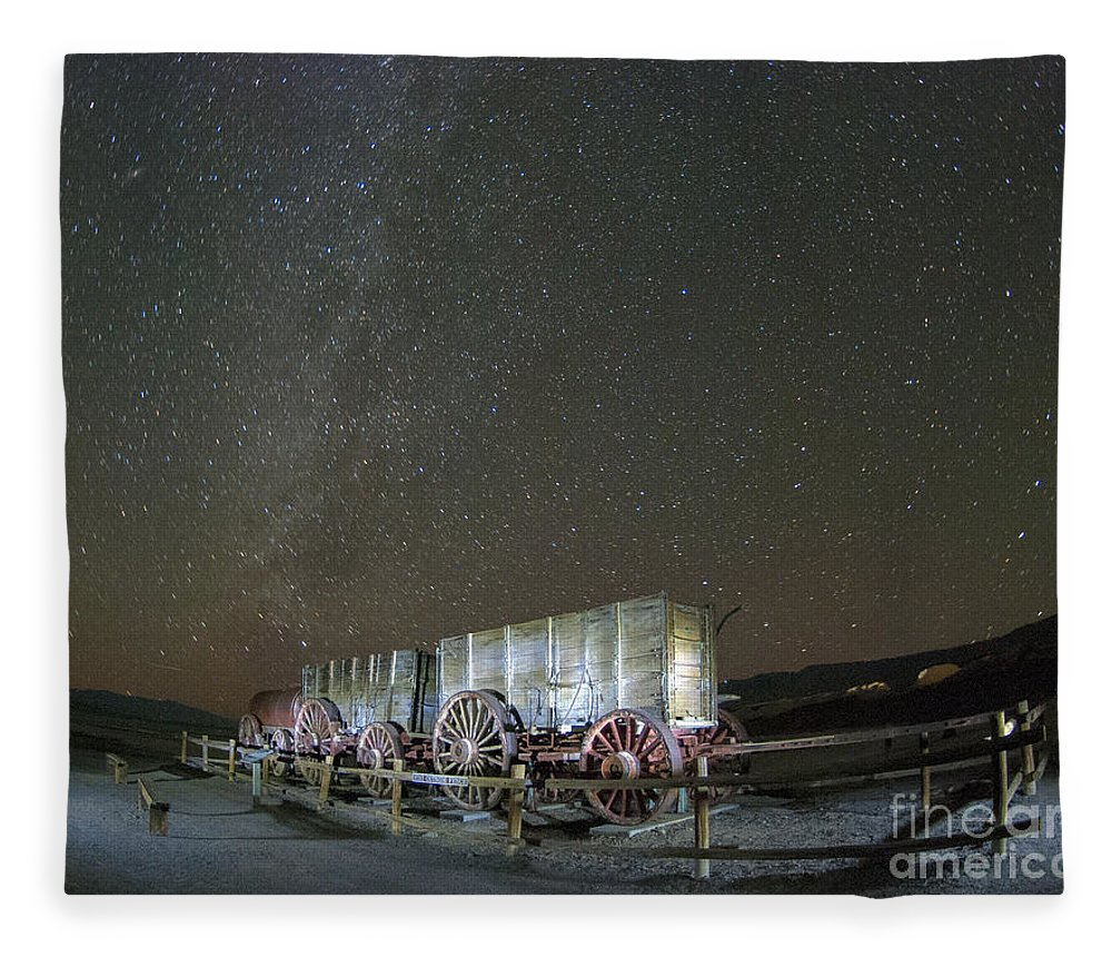 America Fleece Blanket featuring the photograph Wagon Train Under Night Sky by Juli Scalzi
