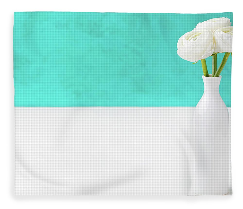 Event Fleece Blanket featuring the photograph White Ranunculus Flowers In A Ceramic by Annapustynnikova