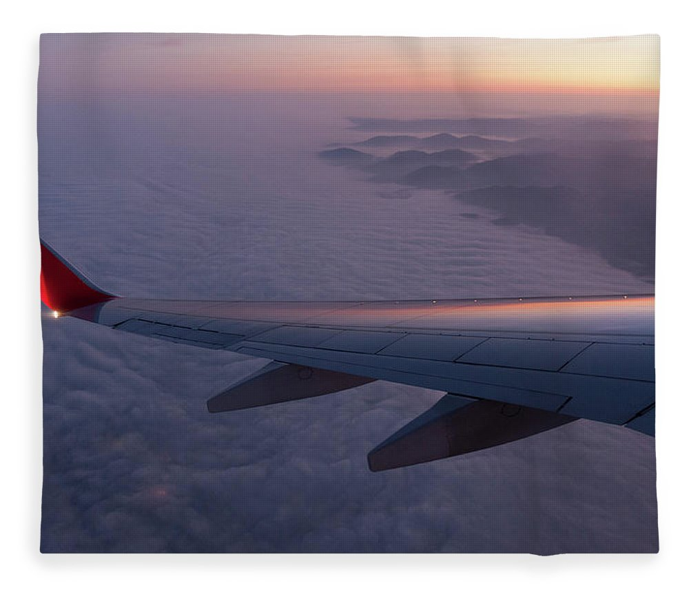 Taking Off Fleece Blanket featuring the photograph Wing Of An Aeroplane With Sunset by Rotofrank