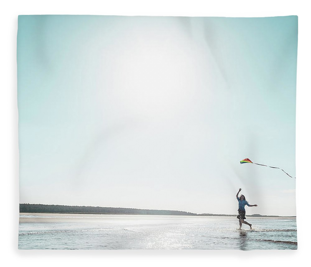 Three Quarter Length Fleece Blanket featuring the photograph Woman Flying Kite On Beach by Dan Brownsword