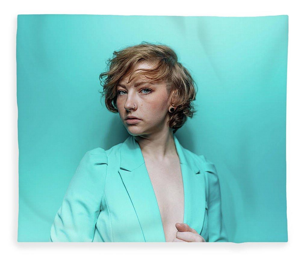 People Fleece Blanket featuring the photograph Woman In Blue Jacket On Blue Background by Ian Ross Pettigrew