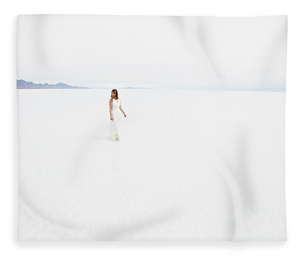 Scenics Fleece Blanket featuring the photograph Woman Wearing Dress Walking Through by Thomas Barwick