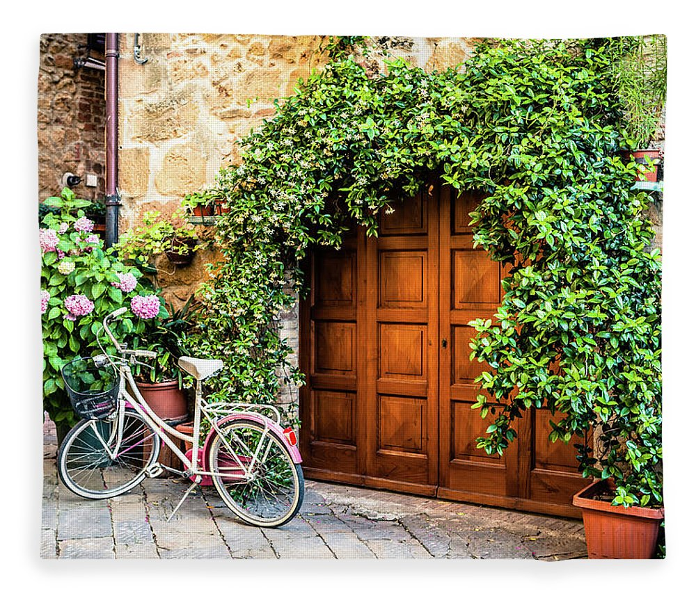 Val D'orcia Fleece Blanket featuring the photograph Wooden Gate With Plants In An Ancient by Giorgiomagini