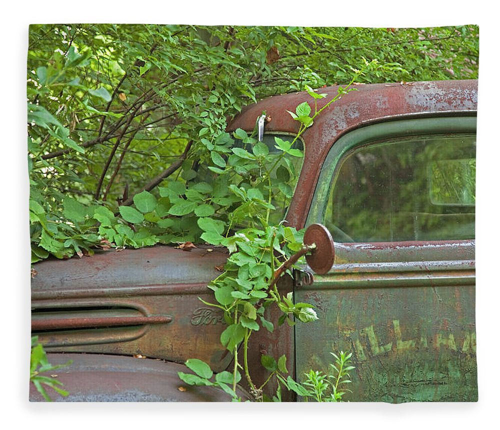 Rustbuckets Fleece Blanket featuring the photograph Overgrown Rusty Ford Pickup Truck by John Stephens
