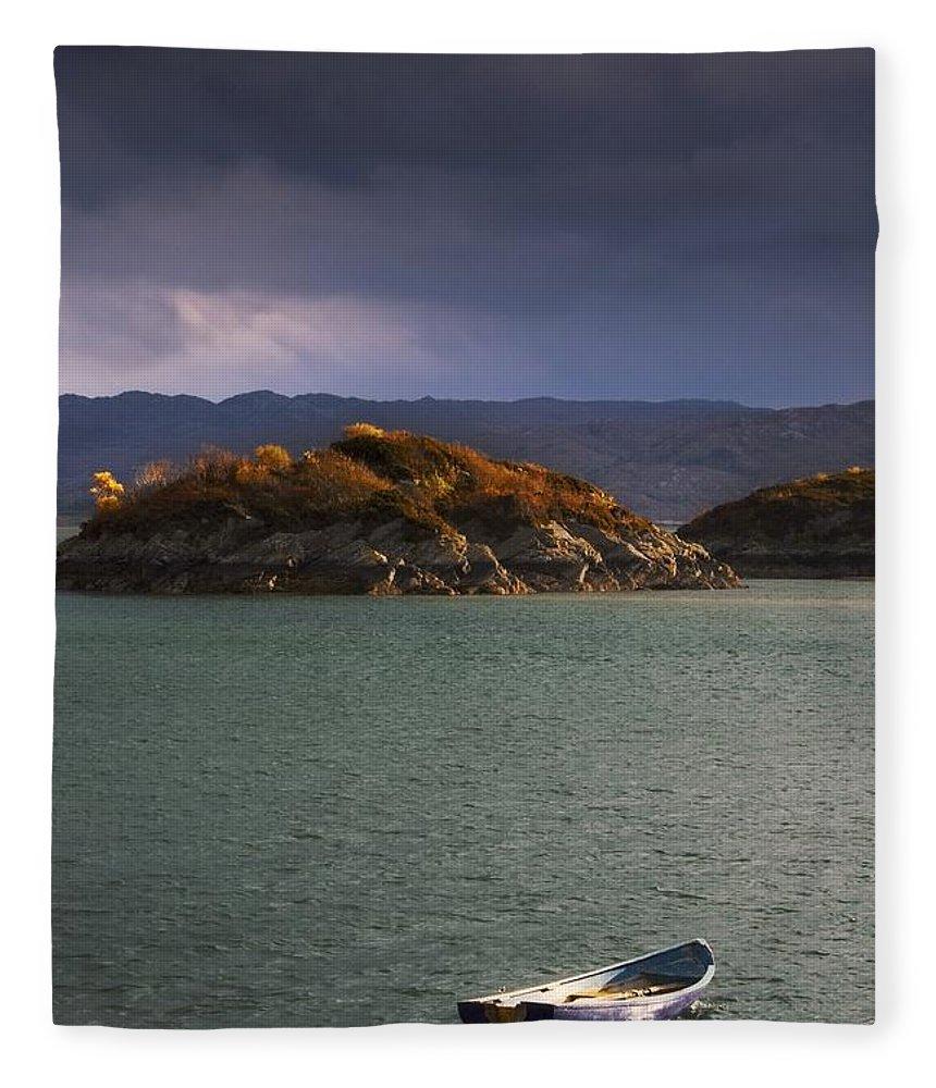 Anchored Fleece Blanket featuring the photograph Boat On Loch Sunart, Scotland by John Short