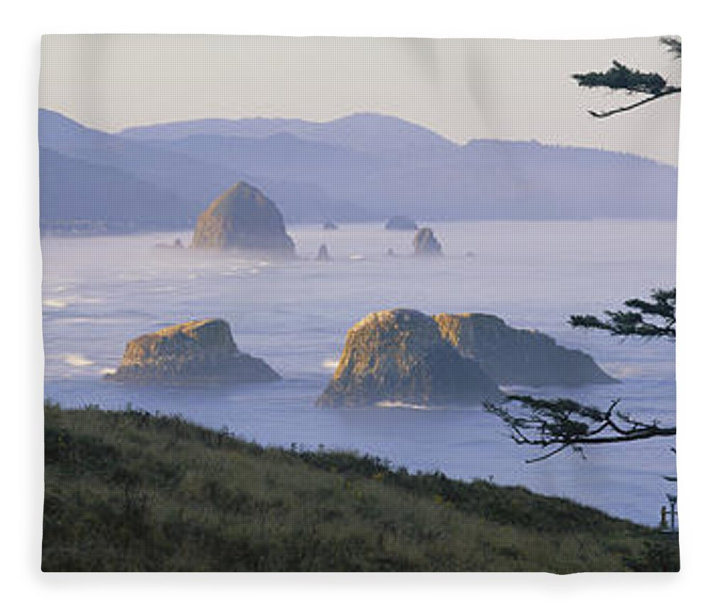 Nature Fleece Blanket featuring the photograph Cannon Beach by Chromosohm Media Inc and Photo Researchers