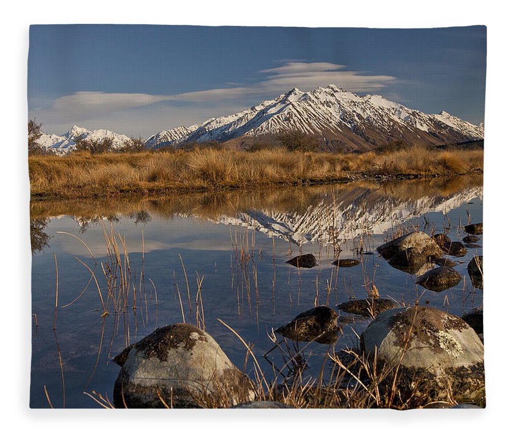 Hhh Fleece Blanket featuring the photograph Erwhon Station Reflection In Branch by Colin Monteath
