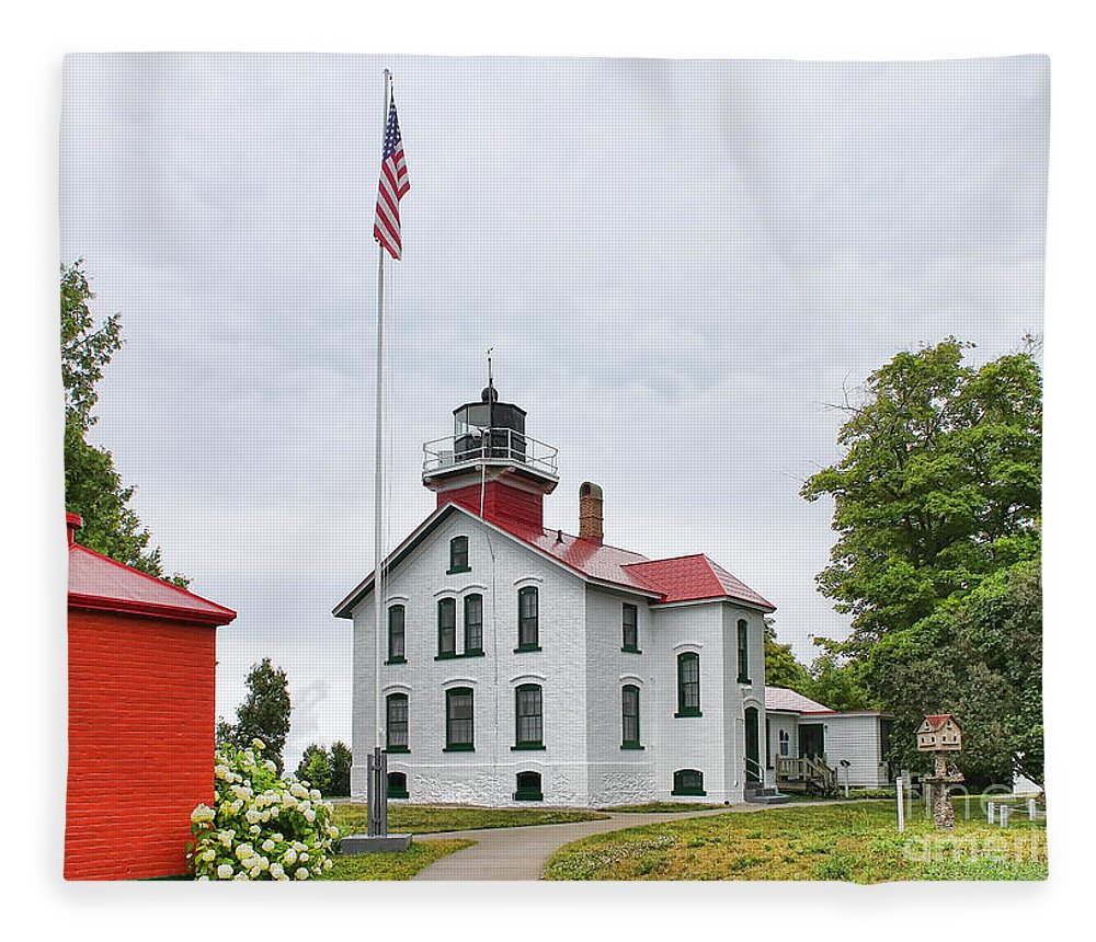 Grand Traverse Lighthouse Fleece Blanket featuring the photograph Grand Traverse Lighthouse by Jack Schultz