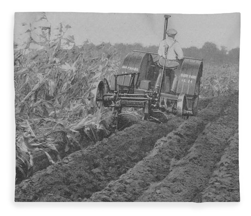 Farm Fleece Blanket featuring the photograph A Farmer Driving A Tractor by American School