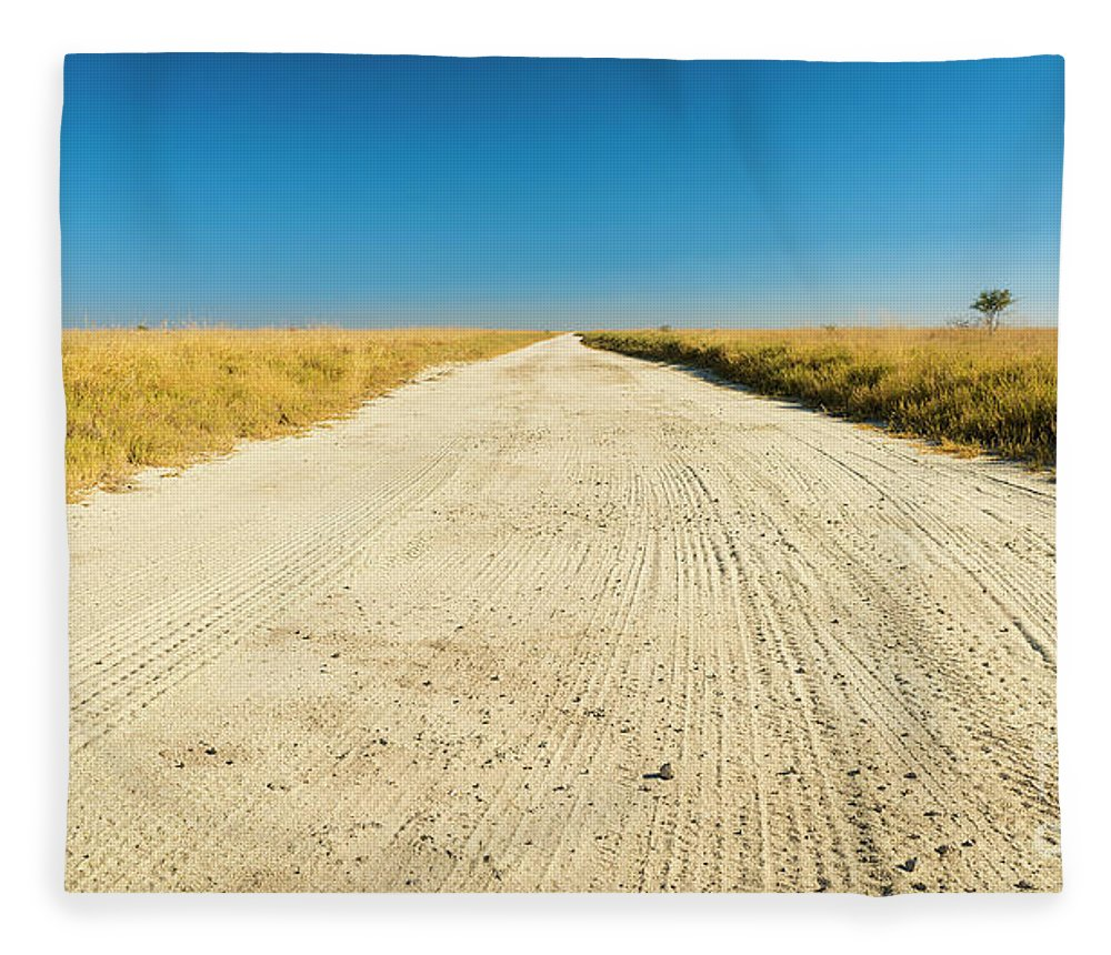Road Fleece Blanket featuring the photograph Africa Plains Road by Tim Hester
