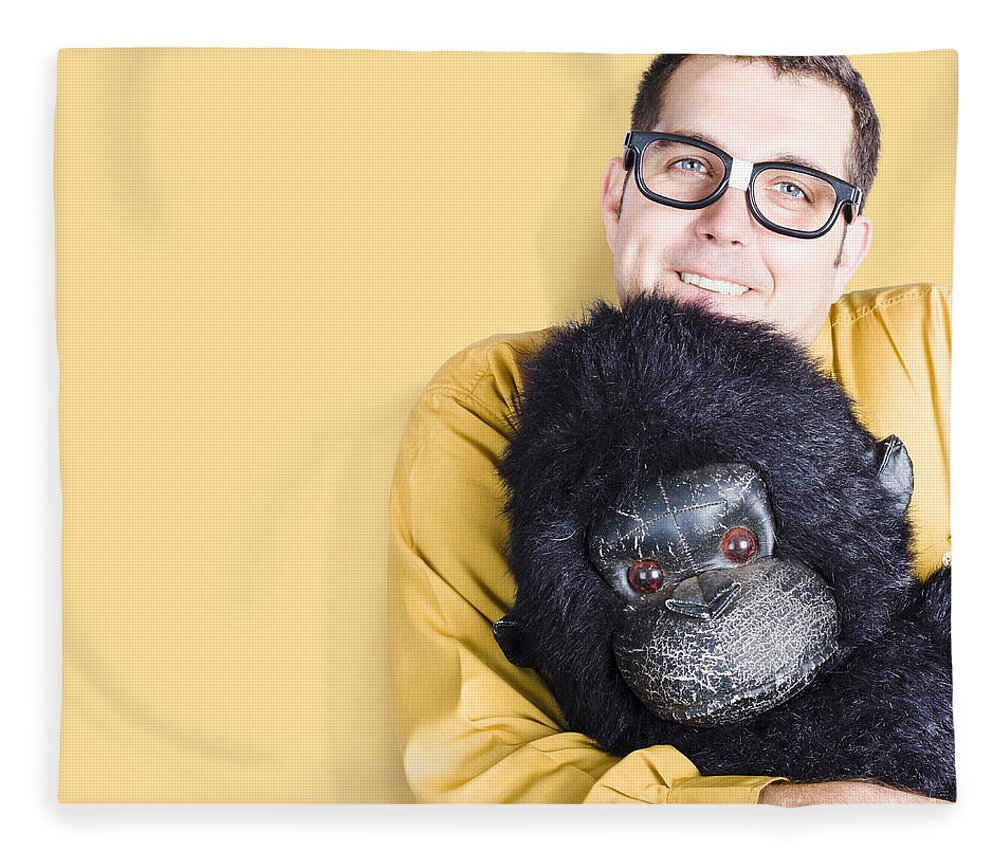 Comfort Fleece Blanket featuring the photograph Big Male Goof Cuddling Toy Gorilla. Comfort Zone by Jorgo Photography - Wall Art Gallery