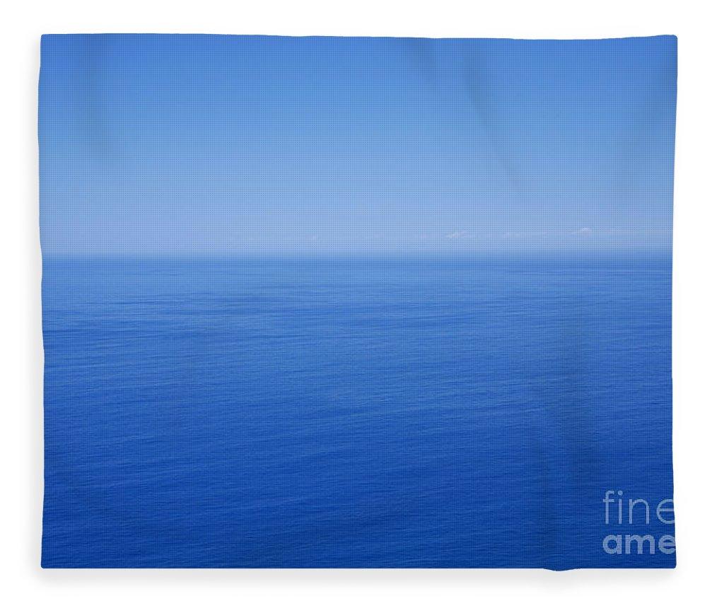 Tranquility Fleece Blanket featuring the photograph Blue Horizon by Gaspar Avila