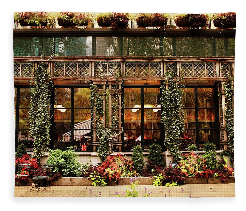 Bryant Park Fleece Blanket featuring the photograph Bryant Park Grill by Jessica Jenney