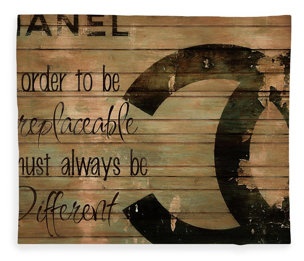 Chanel Wood Panel Rustic Quote Fleece Blanket featuring the mixed media Chanel Wood Panel Rustic Quote by Dan Sproul